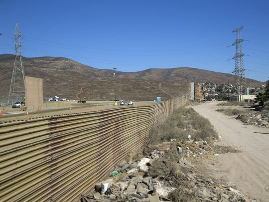 A border-wall prototype is seen among the construction of the prototypes near the Otay Mesa Port of Entry outside of San Diego, as seen from behind the pre-existing border fencing on U.S.-Mexico border on Oct. 16, 2017.