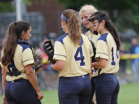 Down by five runs, Indian Hills chat at the pitchers