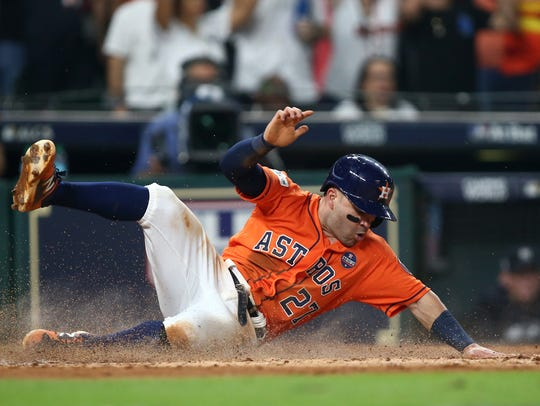 Houston Astros second baseman Jose Altuve (27) slides