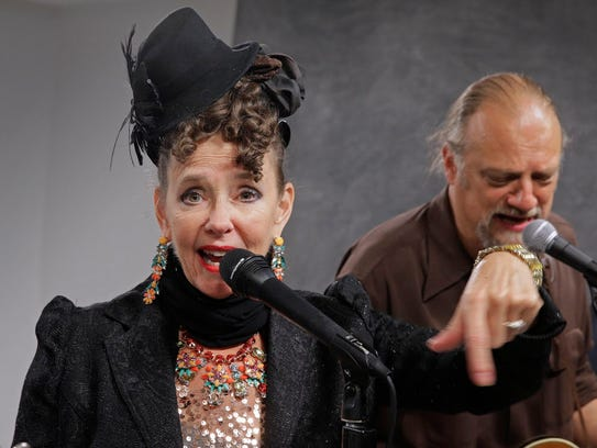 Robin Pluer (left) performs a holiday concert Friday