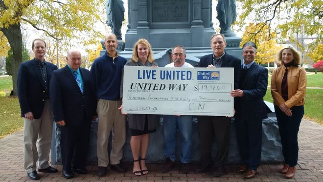 Accepting the check from CN from left to right: Joseph Moore, Fond du Lac city manager; Allen Buechel, Fond du Lac county executive; Mike Mockert, United Way Board of Directors; Amber Kilawee, executive director of Fond du Lac Area United Way; John Cooper, United Way campaign captain for nonprofits; Kevin Soucie, CN director of government affairs; Pat Friedel, United Way campaign captain for North Fond du Lac; and Barb Bossenbroeck, United Way Board of Directors.