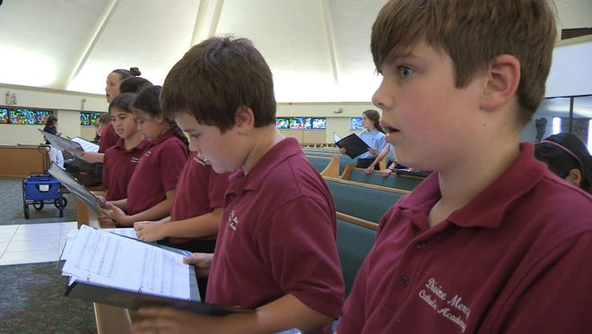 Twenty-one members of the Divine Mercy Catholic Academy's children's choir will head to the Vatican to sing for the Pope on Jan. 6.