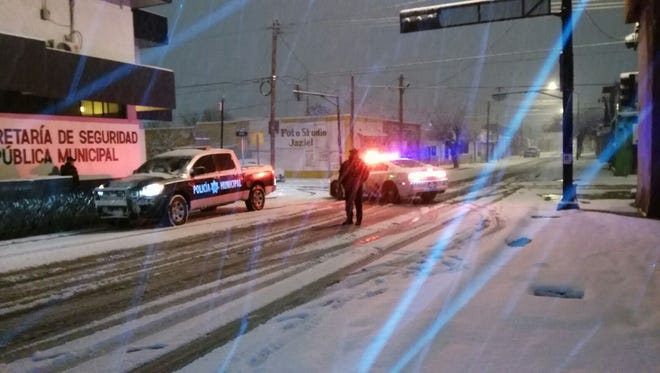 Juárez police patrol while snow fell on the city last month.