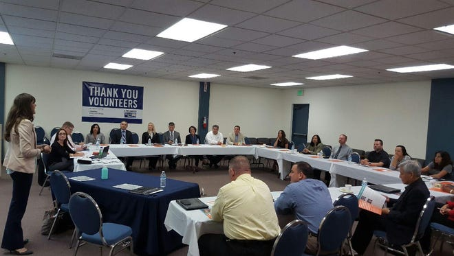 Elizabeth Schott, Accion's CEO, speaks to a group of local leaders at a United Way of the Inland Valleys meeting in 2015.