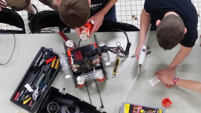 Oostburg Middle School's ROV team hard at work on the ROV that took first in the Wisconsin MATE underwater robotics competition.