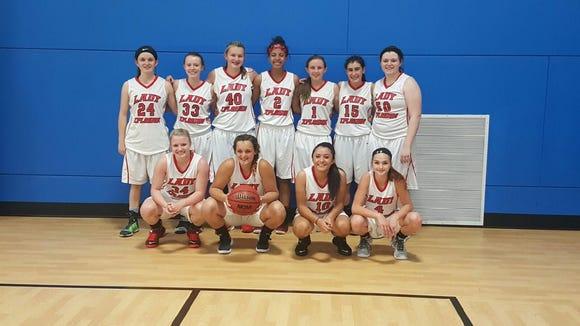 The Lady Xplosion 10th grade girls basketball team