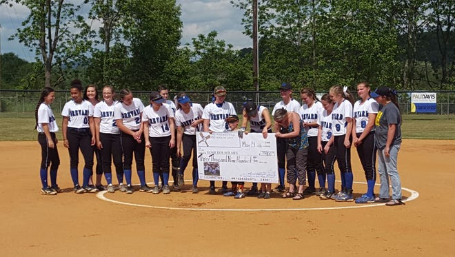 Brevard softball players presented the Desmelik family with a check for $3,900 on Saturday.