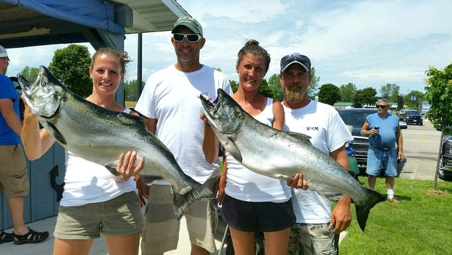 Ann Smith, John Meyer, Mark Lee and Heather Last teamed up to win the Kewaunee Offshore Challenge fishing contest.