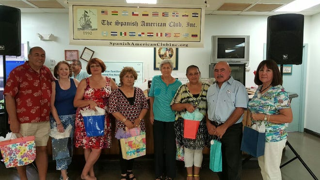 Other raffle winners: From left Tony Colón, Sandy Coughlin, Blanca Stella Paez, Ligia Bernas, Ana Rodriguez, Augusto Rodriguez and Nancy Rozon