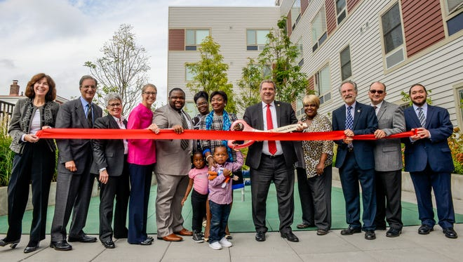 Local officials cut a ribbon at 188 Warburton Ave., the second phase of the redevelopment of the Cottage Place Gardens public housing complex.