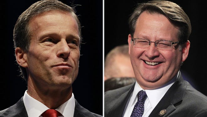 U.S. Sens. John Thune, R-S.D., and Gary Peters, D-Mich.