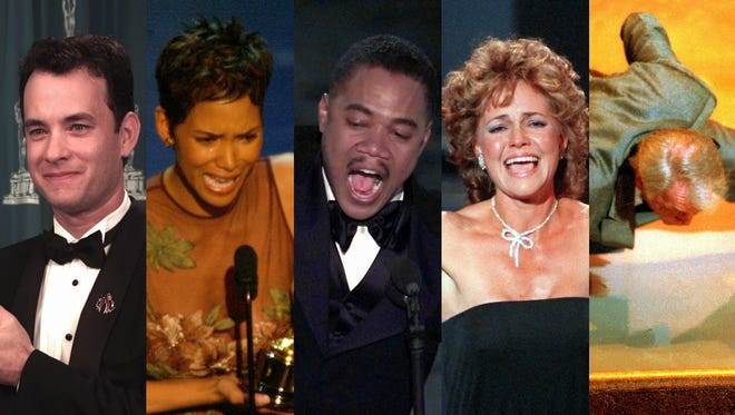Tom Hanks, Halle Berry, Cuba Gooding Jr., Sally Field and Jack Palance celebrate their Oscar wins in their own ways.