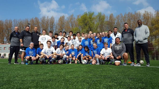Kentucky ODP boys and girls teams pose for a photo at Feyenoord's training ground.
