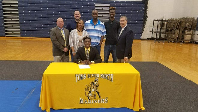 Toms River North senior guard Jaden Rhoden recently signed with Assumption College in Worcester, Mass. Joining him for the signing are his family members, Toms River North's principal Ed Keller, Toms River North boys basketball coach Rory Caswell and Toms River North Athletic Coordinator Paul Barnowski.