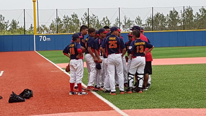 Team Guam gathers to show their sportsmanship after their 8-3 win over Hong Kong, good for third place overall in the Little League Asia Pacific & Middle East Regional Championships, held in Hwaseong, South Korea.