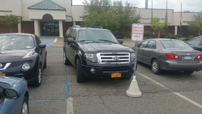 The Spring Valley purchased Ford Expedition used by Mayor Demeza Delhomme that became the center of legal action with several trustees. The cars is parked in front of Spring Valley Village Hall.