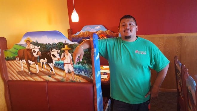 El Javenaso owner Jamie Jacinto stands next to newly crafted furniture for his Mexican Restaurant opening Wednesday in Medford.