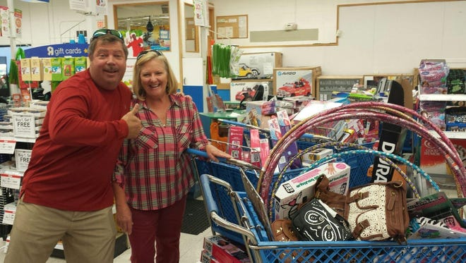 Mike and Marsha Ewing shopped for toys to make the season bright for more than 3,000 children last year.