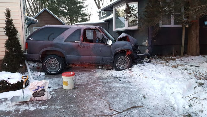 This SUV driven by a 32-year-old Marshfield man crashed into a house in Marshfield.