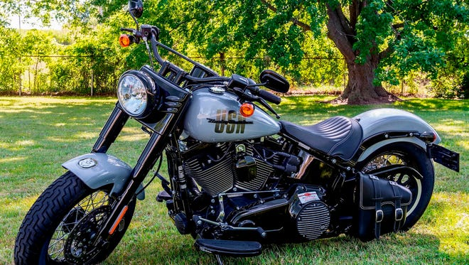 Harley-Davidson customized this 2016 Softail Slim as a tribute to the Navy's USS Milwaukee littoral combat ship. The bike will be auctioned Friday in Las Vegas, with the proceeds going to the National Military Family Association.