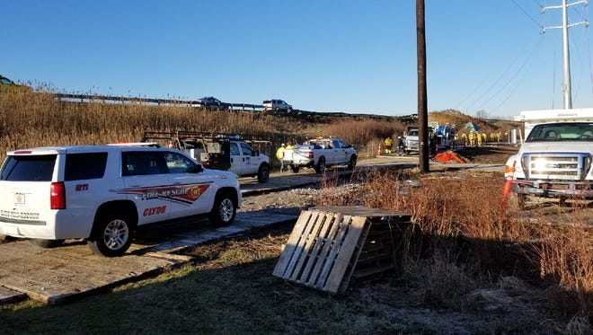 A semi carrying 47,000 gallons of palm oil crashed through a guard rail on the Ohio Turnpike Monday and rolled down an embankment near County Road 232.
