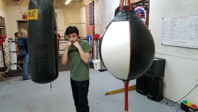 Juan Mata, 16, seeks to defend his title in the Golden Gloves boxing tournament in Toledo starting Saturday.