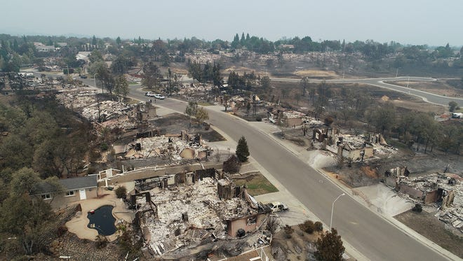 Homes in the River Ridge Terrace subdivision show the damage from the Carr Fire Wednesday August 1, 2018 in Redding, CA. These homes in the 1300 block of Spinnaker Drive are completely destroyed.