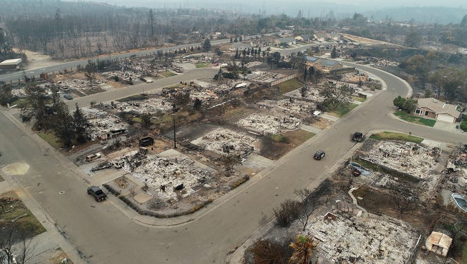 A view of the Lake Keswick Estates neighborhood on the northwest side of Redding, CA. This view from the corner of Menlo Way, to the left and Cape Cod Drive looking west shows the devastation from the Carr Fire as it moved through the area.