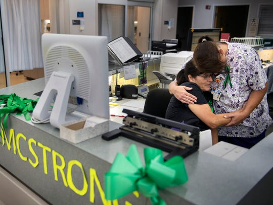 """Behind a desk decorated with the words """"HCMC Strong,"""" nurse Terry Ward, of Palmersville, embraces phlebotomist Christi Snow on Friday, October 6, 2017, as they mourn their late coworker Sonny Melton in the ER of Henry County Medical Center. The 29-year-old registered nurse died in the gunfire during the Las Vegas shooting last weekend. """"I cried all day Monday, when we found out,"""" said Ward, who had worked with Sonny for two years. """"Sonny was just like his name. He was a ray of sunshine. When he walked in the room the whole world got brighter."""""""