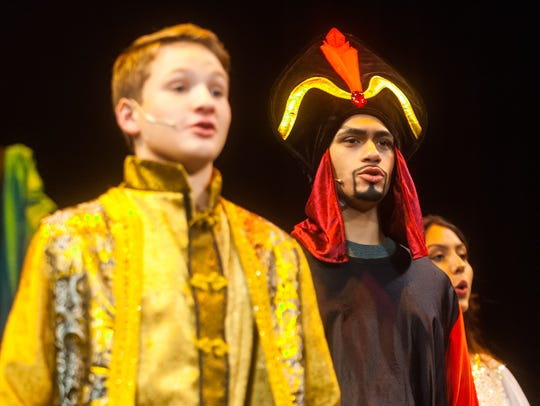 Jafar, played by Colby Martinez, performs during a