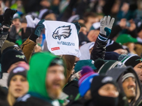 An Eagles fan holds up a towel during a game against the Falcons at Lincoln Financial Field on Saturday, January 13.