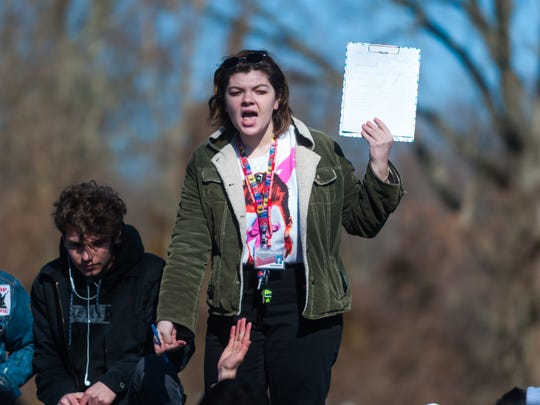 Vineland student Zoey Fischer holds up a petition after
