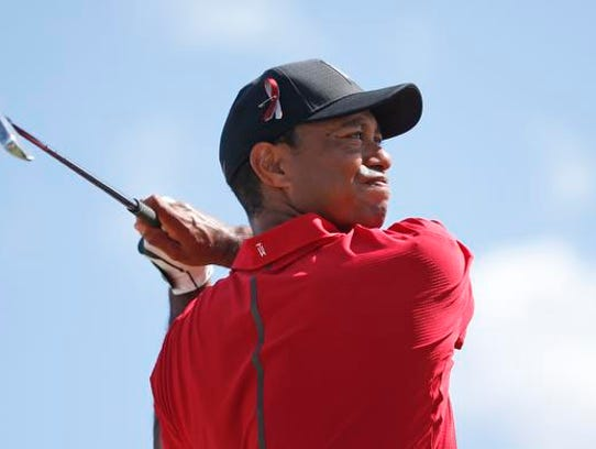 Tiger Woods tees off on the fourth hole during the