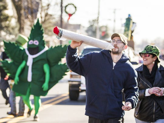 Hempy Leaf, the mascot of Delaware NORML, marches during