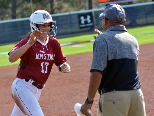 Kelsey Horton gets congratulated by Aggie Assistant