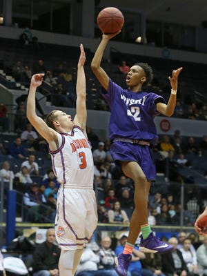 Greece Odyssey's Jaden Hartsfield puts up a running shot over Livonia's Alex Minnehan during the 2018 Section V Class B final at the Blue Cross Arena at the War Memorial. Odyssey