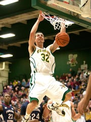 Ethan O'Day (center) of Vermont throws down a dunk for the Catamounts at Patrick Gymnasium in 2012.