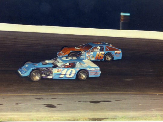Tony Roper (car No. 10) passes Dale Roper (16) during a 1990 race at I-70 Speedway in Odessa.