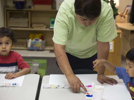 Virginia Palacios works with her preschool students