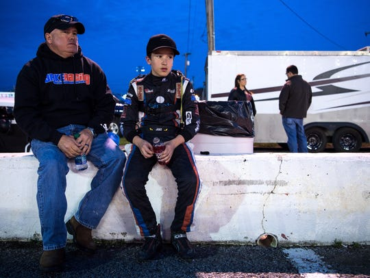 13-year-old race car driver Jake Garcia sits with his