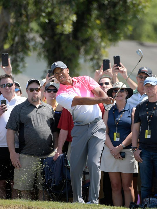 Tiger Woods chips onto the third green during the second round of the Arnold Palmer Invitational golf tournament Friday, March 16, 2018, in Orlando, Fla. (AP Photo/Phelan M. Ebenhack)