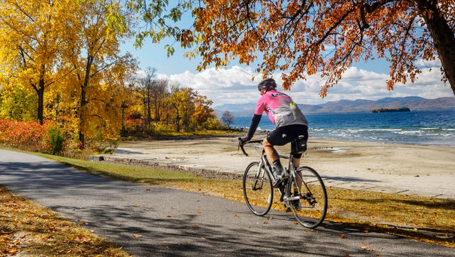 In this Oct. 19, 2016 photo provided by Local Motion, a man cycles along the Island Line Rail Trail in Burlington.
