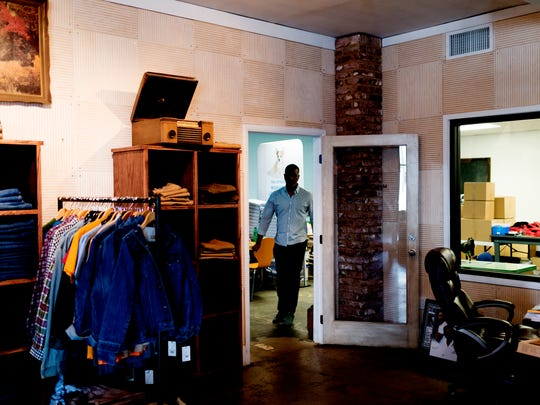 Marcus Hall walks from the back room into the store room at his store on 700 E Depot Ave in Knoxville, Tennessee on Friday, May 25, 2018. Nelson has recently returned to working at his denim business after serving time in prison for money laundering.