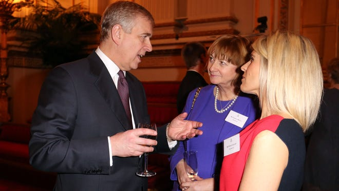 Prince Andrew talks to guests at Buckingham Palace reception for Prince Edward and Sophie Countess of Wessex on Feb. 10.