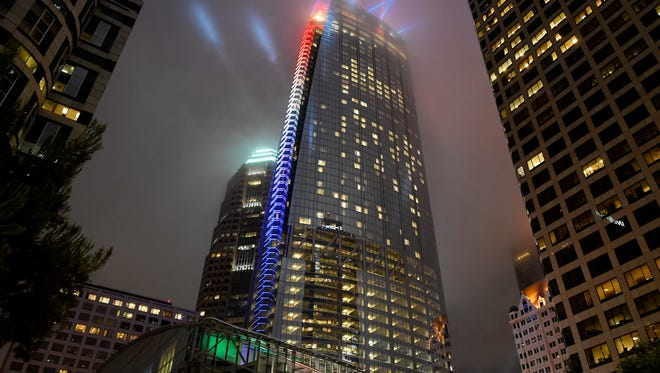 A light show illuminates Wilshire Grand Center to celebrate its grand opening on  Friday.
