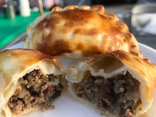 Pilar's beef empanadas are mixed with raisins and olives,