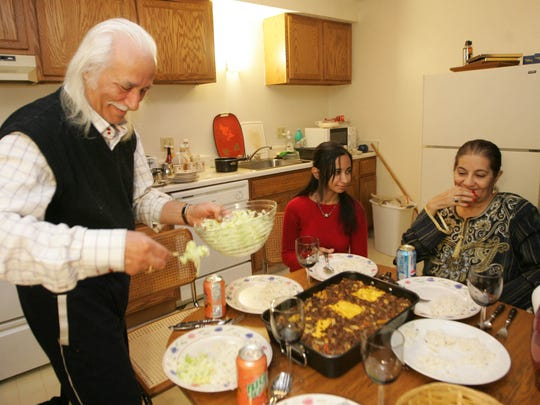 "From 2008: Amer Saleh al-Obaidi served shredded lettuce, goulash and rice for his daughter, Bedor, and his wife, Sawsan. He was still learning to cook but was making progress, according to Sawsan, who sampled some of the sauce. ""It's very good,"" she said. ""My husband is good man. He is magic."" Because the family does not own a car, they take the bus to shop at Hy-Vee and Hilal Groceries, a Middle Eastern food store near Drake University."