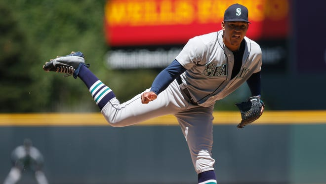 Seattle Mariners starting pitcher Taijuan Walker works against the Colorado Rockies in the first inning of an interleague baseball game Wednesday, Aug. 5, 2015, in Denver.
