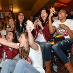 Members of the New Mexico State volleyball team react to the announcement that they will play Stanford in the first round of the NCAA Volleyball Tournament during a selection watch party Sunday night at the NMSU Golf Course.