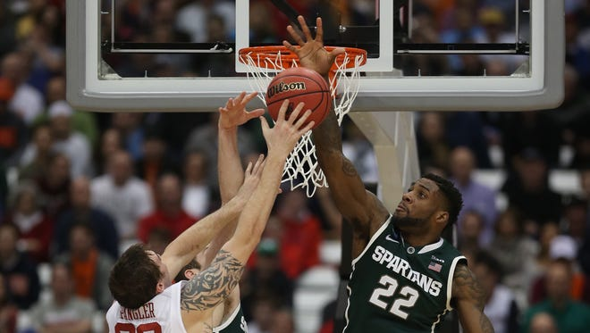 Michigan State's Branden Dawson defends against the Oklahoma Sooners Ryan Spangler during the second half of the NCAA East Regionalsemifinals on Friday, March 27,2015 at Carrier Dome in Syracuse N.Y..